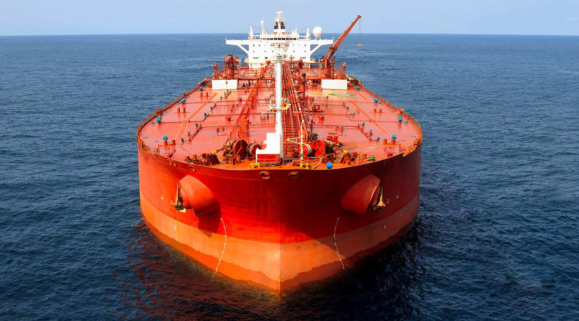 An large red oil tanker requires large ship financing services