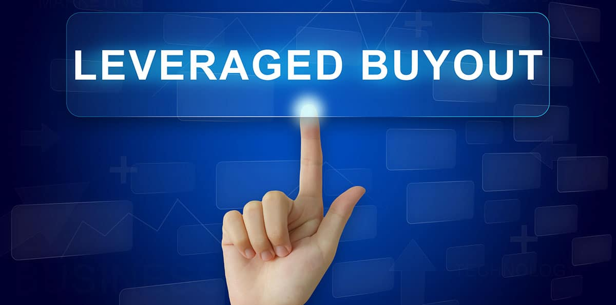 A hand points to a leveraged buyout sign